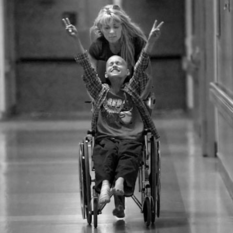 May 10, 2006 - Sacramento, California, U.S. - CYNDIE FRENCH races her son DEREK MADESEN, 11, barefoot up and down the halls of the UC Davis Medical Center to distract him from a painful, pending bone marrow transplant. Derek died later that month, at home in his mother's arms at the age of 11, from cancer. (Credit Image: © Renee C. Byer/Sacramento Bee/ZUMAPRESS.com)